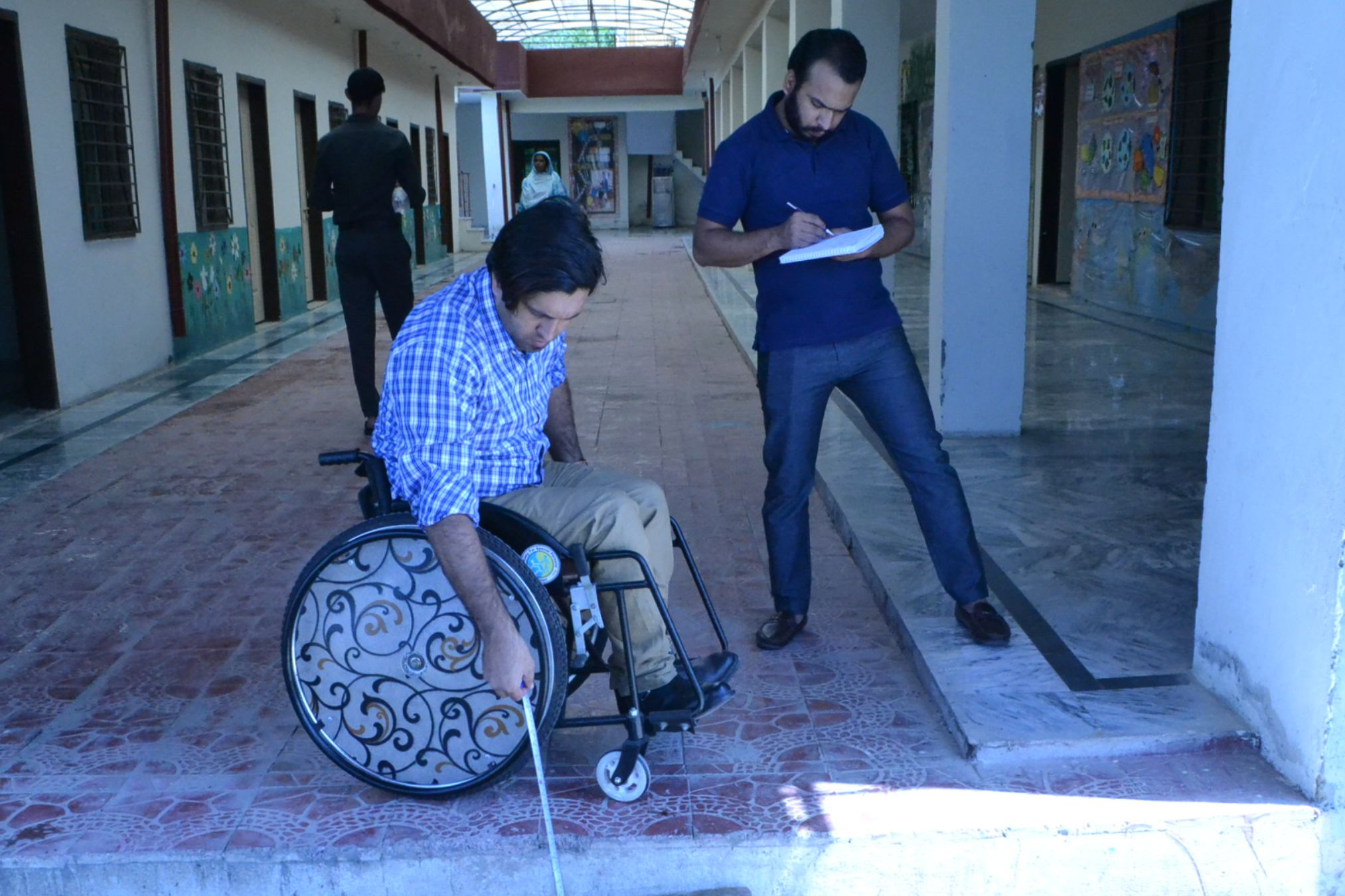 Wheelchair User taking Measurements